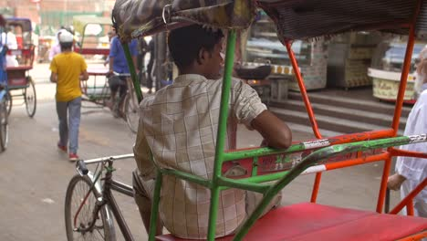 Handheld-Shot-of-a-Driver-Sitting-in-a-Rickshaw