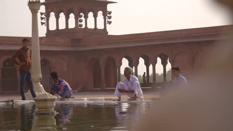 Reveal-Shot-of-People-Bathing-at-Jama-Masjid