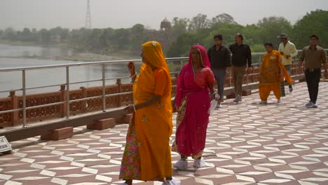 Slow-Motion-Shot-of-Two-Women-in-Saris-Walking