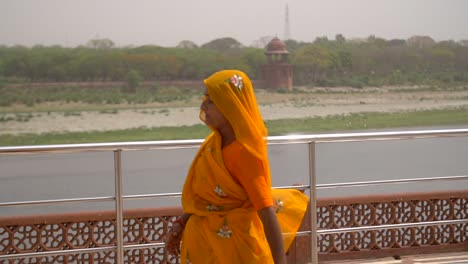 Slow-Motion-Shot-of-a-Woman-in-an-Orange-Sari