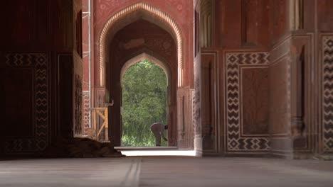 Man-in-an-Archway-Unlocking-a-Door