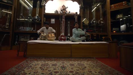 Two-Men-Playing-Indian-Music-in-a-Music-Shop