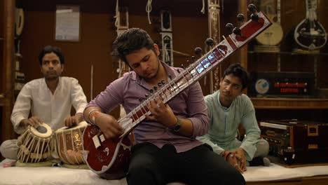 Three-Men-Making-Music-in-a-Music-Shop