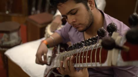 Close-Up-of-Man-Playing-a-Sitar