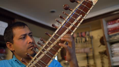 Man-Playing-a-Sitar