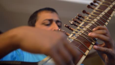 Man-Playing-Sitar