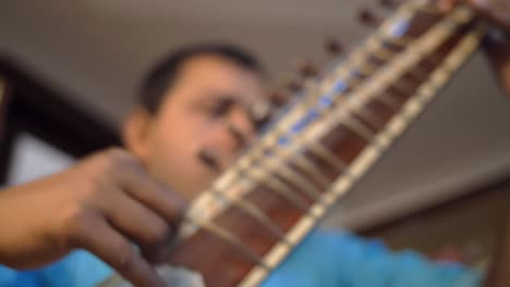Man-Playing-the-Sitar
