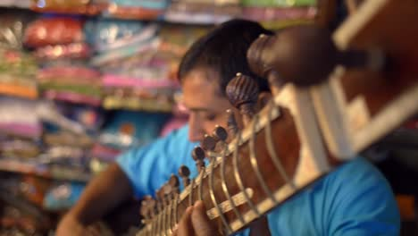 Close-Up-Panning-Shot-of-a-Man-Playing-a-Sitar