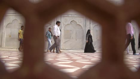 Shot-of-Woman-in-a-Niqab-Through-a-Stone-Grate