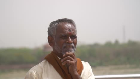 Elderly-Indian-Man-Rubbing-His-Beard