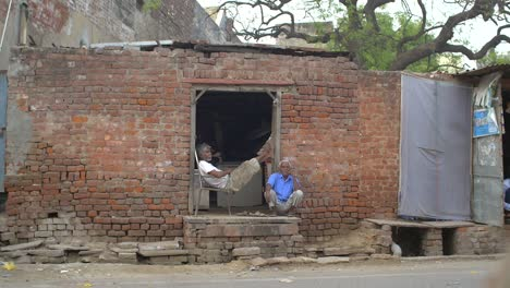 Two-Indian-Men-Sitting-in-a-Doorway