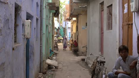 Woman-Walking-Down-Indian-Alleyway