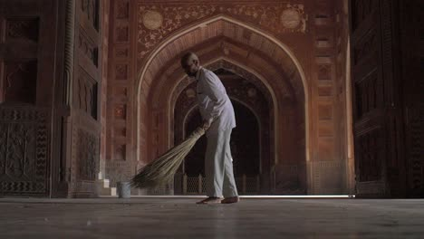 Man-Sweeping-Dirty-Floor