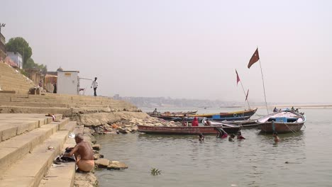 Man-Crouching-on-the-Ganges-Ghats