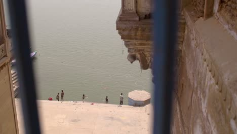 Shot-of-Ganges-Riverbank-Through-a-Railing