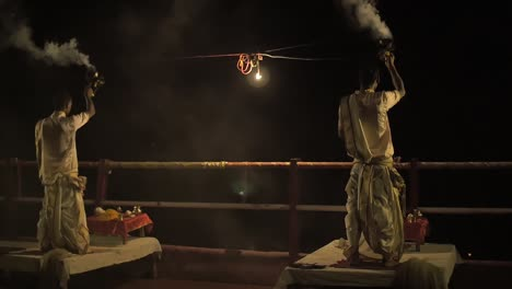 Panning-Shot-of-Men-Burning-Incense-at-Night