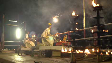 Low-Level-Shot-of-Men-Performing-Ganga-Aarti