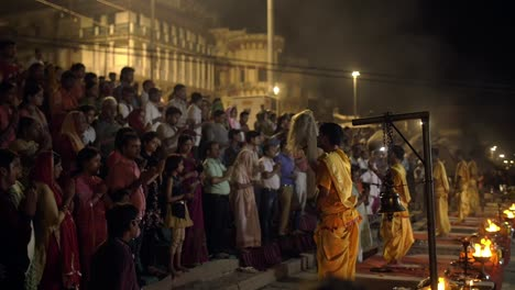 Men-and-Women-Praying-at-Ceremony-in-Varanasi