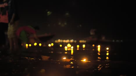 Focus-Pull-of-Puja-Candles-on-the-River-Ganges