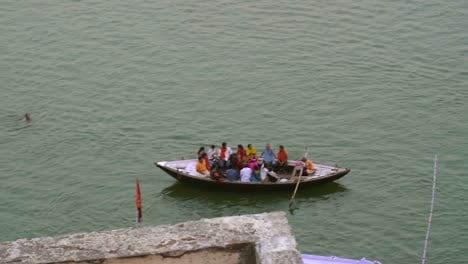 Panning-Shot-of-Rowing-Boats-on-the-Ganges