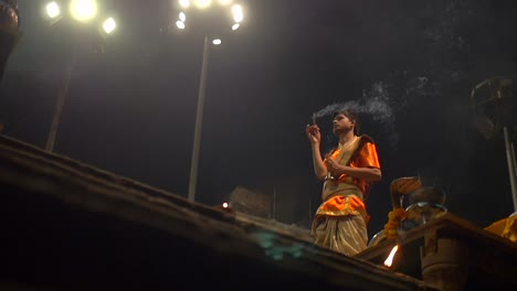 Indian-Man-Waving-Incense-and-Ringing-a-Bell