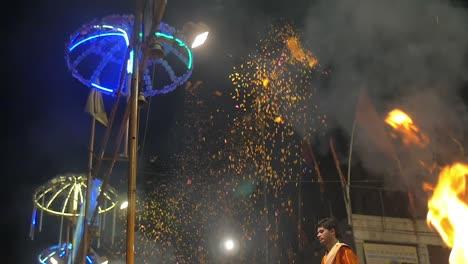 Indian-Men-Throw-Marigold-Petals-Into-the-Air