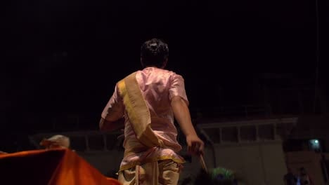 Reveal-Shot-of-Nighttime-Ceremony-in-Varanasi