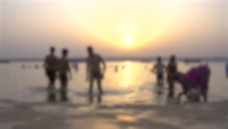 Out-Of-Focus-People-Bathing-in-Ganges-River