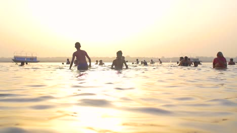 Man-Wades-into-the-Ganges-at-Sunset
