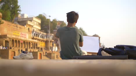 Man-Drawing-at-Sunset