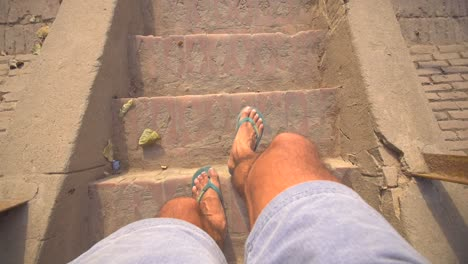 POV-Shot-of-Feet-Walking-Down-Some-Steps