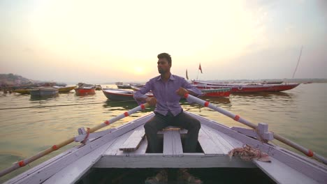 Man-Rowing-Boat-on-Ganges-at-Sunset