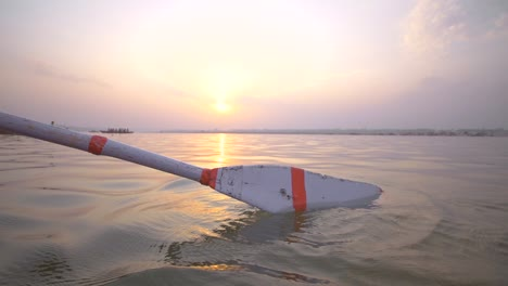Oar-Entering-the-Water-at-Sunset