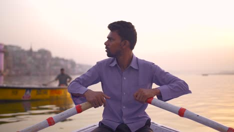 Close-Up-of-Man-Rowing-on-the-Ganges-at-Sunset