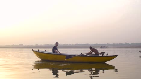 Boat-Being-Rowed-Down-River-Ganges