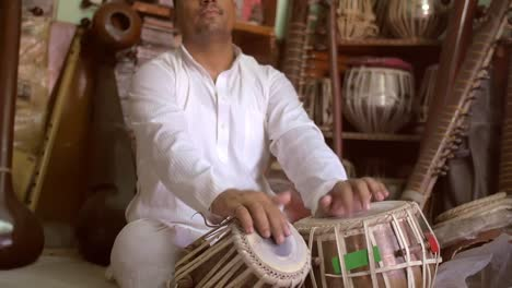 Cross-Legged-Man-Playing-Tabla
