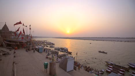 Shot-of-Flags-by-the-Ganges-at-Sunset