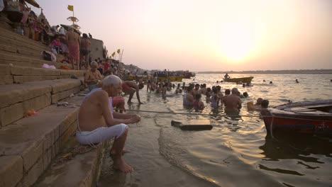 Man-Washing-Metal-Jug-by-the-Ganges