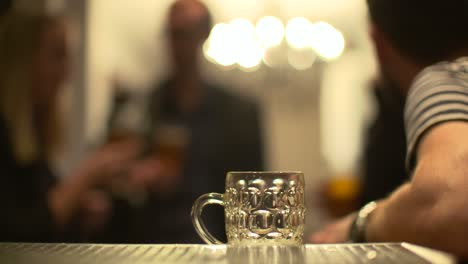 Out-of-Focus-Group-of-Friends-Talk-in-Bar