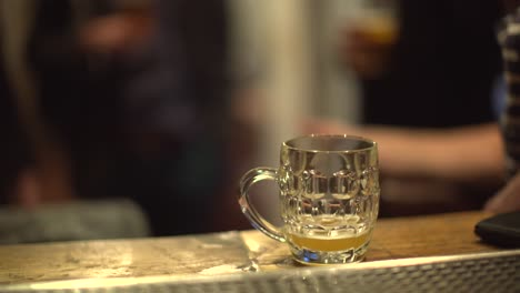 Glass-of-Beer-on-Bar