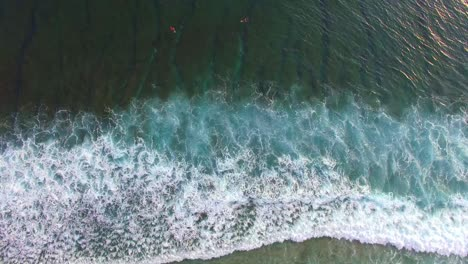 Flying-Over-Surfers-in-Picturesque-Indonesian-Bay