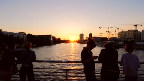 Tourists-Overlooking-Berlin-Cityscape-at-Sunset
