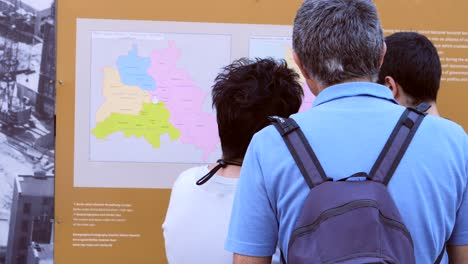 Tourists-Reading-Information-Board-In-Berlin