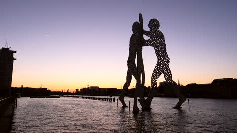 Berlin-Skyline-and-Molecule-Man-Silhouetted-at-Sunset