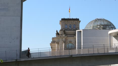 Man-Overlooking-Reichstag-Building