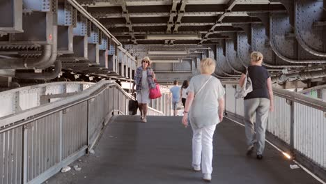 People-Walking-Under-Bridge-in-Berlin