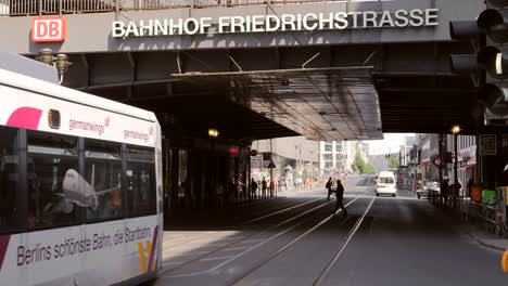 Tram-Passing-Under-Bridge-in-Berlin
