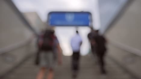 Out-of-Focus-Shot-of-People-Leaving-Train-Station