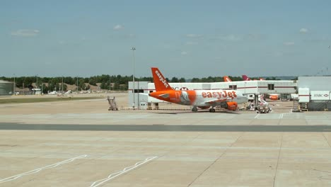 EasyJet-Plane-at-Airport-Terminal