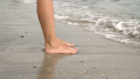 Waves-Breaking-Over-Ladies-Feet